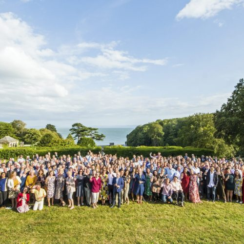 Alumni group photo on the top lawn of St Donat's Castle
