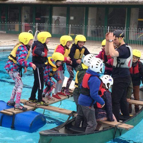 Children in the pool at UWC Atlantic
