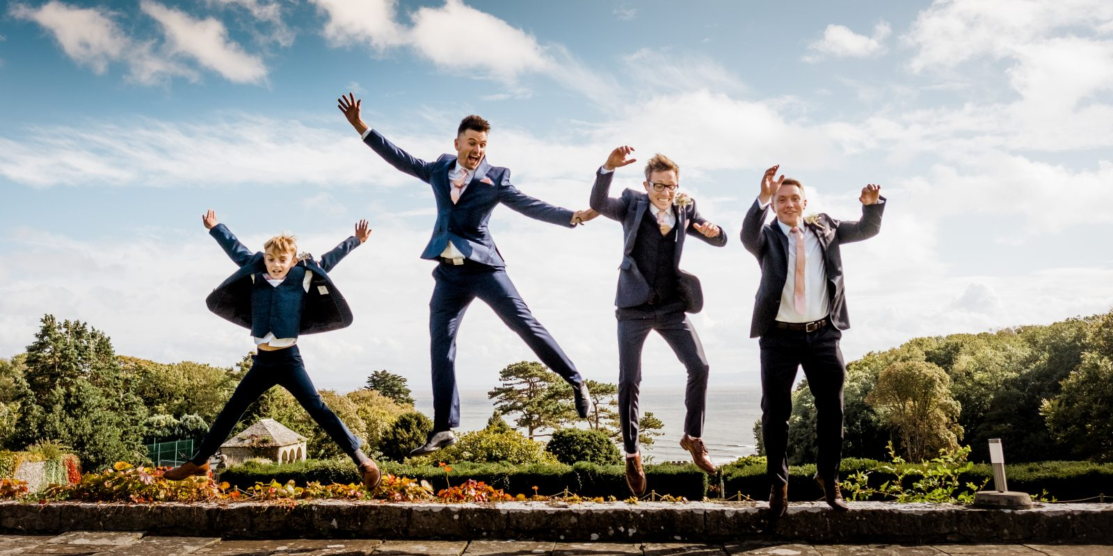 grooms jumping wedding photography