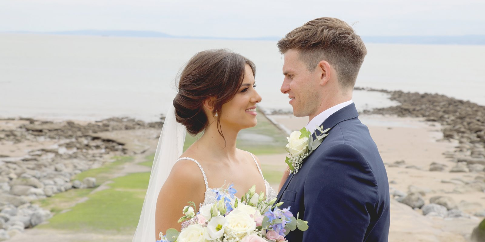 wedding couple on st donats bay seafront